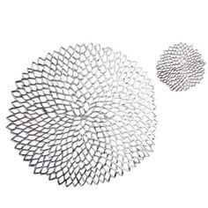 A modern rendition of a doily, these table linens surround and enhance table settings. Made from phthalate-free vinyl, it forms its delicate shape from a unique mold. Coaster and Placemat sold below.<br><br>Started by a husband-and-wife duo, Chilewich is a design company dedicated to developments in the green movement. Each product they craft has a long lifecycle and utilizes phthalate-free, renewable compounds and non-toxic dyes.
