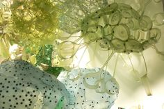 Aurora Robson is a multi-media artist known predominantly for her transformative work interrupting the waste stream using plastic debris, excess packaging and junk mail.