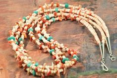 Beautiful 3 Strand Necklace featuring Genuine Melon Shell with accents of  Spiny Oyster Shell and Turquoise.  Sterling Silver Cones and Clasp. Created by Santo Domingo Artist Carol Pacheco. The Santo Domingo Pueblo is in New Mexico, near Santa Fe. ...$135