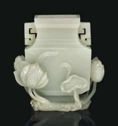 A SMALL PALE GREENISH-WHITE JADE FACETED VASE -  18TH/19TH CENTURY.