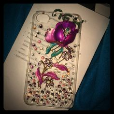 """NFSNEX iPhone Elite 3D Dazzle Cover NEX high quality electronics fashion.  Used once.  Still have/kept in box.  Beautiful! Sparkling! Original! Thin and compact protection for pocket carrying. Clear, plastic back cover with 3D magenta rose.  Covered in pink, white and purple iridescent rhinestones.  Rose has gold toned stem and outline of flower. Very nice and sturdy phone cover, with all stones and details in tact.  """"The case will beautify your mobile phone, and protect your phone to avoid…"""