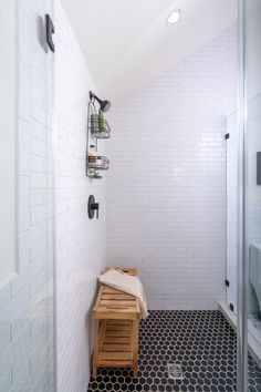 This handmade black and white tile bathroom makes mixing patterns look effortless with a blend of subway and hex tiles. Mosaic Shower Tile, White Tile Shower, Black And White Tiles Bathroom, Shower Floor Tile, Bathroom Tile Designs, White Wash Walls, Herringbone Tile Floors, Fireclay Tile, Floor Colors