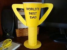 """This  """"World's Best Dad Trophy"""" is a great idea for a Mother's Day or Father's Day project for your students to complete.  The materials needed are easy to gather together:  paper cup, toilet paper roll, cereal box, cardboard, yellow paint, and markers."""