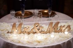 Beautful sweetheart table signs in stunning gold and accented with rose pedals and candle light. This is the most romantic table for the newlyweds that I've ever seen! Perfect for the bride and groom. <3   www.ZCreateDesign.com or ZCreateDesign on Etsy