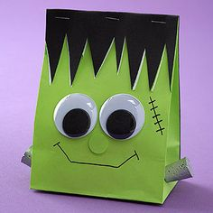 More merry than menacing, this smiling Frankenstein goody bag is a cinch to make using a purchased lime-green sack from a party store. Cover one side of the bag with black card stock; while holding the open edges together, cut out irregular triangles from the top edges of the sack. Fill the bag with treats and fold the black side to the front, stapling along the folded edge to keep the bag closed. Paint two small corks silver, hot-glue the dry corks to the sides of the bag, and add googly…