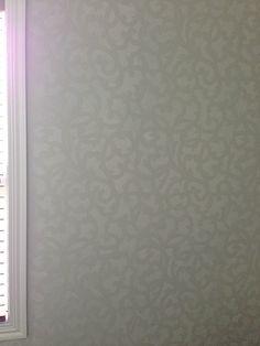 A bathroom wall stenciled with the Venetian Scroll Allover Stencil from Cutting Edge Stencils. http://www.cuttingedgestencils.com/venetian-scroll-allover-stencil-pattern.html