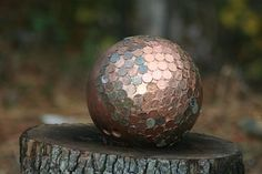 Time to finish my penny gazing bowling-ball.  I pick up pennies off the side walks so it doesn't cost me a penny...(hehehe).  I painted the bowling ball with copper paint first - then glue on the pennies with Goop glue. I leave the holes so people can see it is a bowling ball.