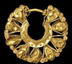 Minoan, circa 1600-1100 BC. A gold openwork earring .