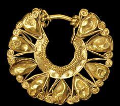 Minoan, circa 1600-1100 BC. A gold openwork earring .