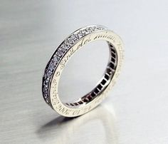 Custom Made Diamond eternity ring with engraving on the side in White gold by Torkkeli Jewellery