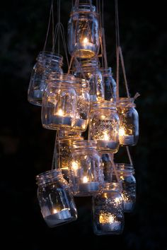 Clusters of mason jar lanterns hung from trees #DIYIdeas