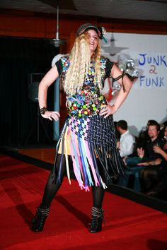 """""""All Zippped Up and Wrapped in Plastic"""" by Deborah Loy, model Blake Schioberg. Made of zippers and plastic. Featured in the 2012 Junk2Funk Eco-Fashion show, a benefit of the Kootenai Environmental Alliance that showcases the runway outfits made from recycled materials by local artists."""