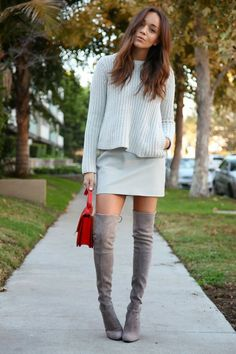 Marry a grey crew-neck pullover with a grey leather mini skirt for an effortless kind of elegance. Grey suede thigh high boots will add elegance to an otherwise simple look.  Shop this look for $113:  http://lookastic.com/women/looks/grey-crew-neck-sweater-grey-mini-skirt-red-satchel-bag-grey-over-the-knee-boots/4644  — Grey Crew-neck Sweater  — Grey Leather Mini Skirt  — Red Leather Satchel Bag  — Grey Suede Over The Knee Boots
