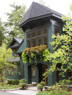From the 1880s into the early 20th century, Shingle-style summer cottages dotted the New England countryside, built as getaways for the well-to-do. The quietly comfortable structures were typically 2,000-2,500 square feet, and the style tended to ramble, spreading out rather than up, with multiple outbuildings. Short on ornamentation, Shingle houses featured curved porches, steeply pitched roofs, towers, and the shingle siding that gives them their name.
