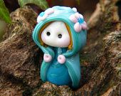 Little Elven girl with Flowers on her hooded cape glass bead