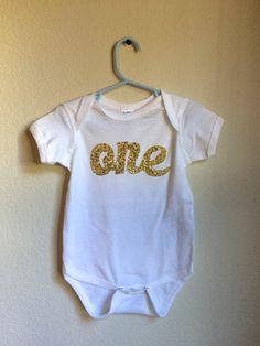 Golden Glitter First Birthday Onesie  1st by JamieVanNuysDesigns