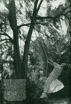 Shalom Harlow swinging in a tree