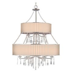 Mara 9-Light Crystal Chandelier in Bridal Veil  Bring chic style to your living room, dining room, or foyer with this elegant chandelier, showcasing crystal accents and a fabric drum shade.   ...