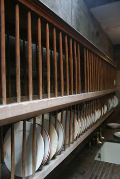kitchen. raw, Plate Rack for china in scullery at Castle Drogo, Devon. photography by Shedopolis (flickr)
