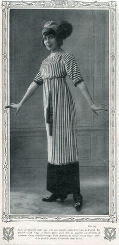 1910 Paul Poiret dress in Chiffons magazine. Mlle Mistinguet, dans une robe très simple mais très jolie de Poiret. En pékiné vieux rouge et blanc, garni d'un peu de dentelle au décolleté et ceinturée d'une cordelière rouge. Petit chapeau de velours vieux rouge, garni d'un pouf de plume d'autruche dans le ton.