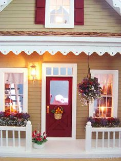 I love the gingerbread wood mill work on the porch... such a cute house