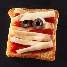 Try this Ghost of a Toast!  You'll need: Toast, pizza sauce, string cheese strands, black olive slices. To make: Top slices of toast with pizza sauce, string cheese strands and black olive slices. Place under the oven's broiler for a minute, just until cheese begins to melt. #Halloween #recipes #easy #fun #Fall