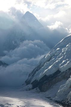6e2576d9469028 Chris Davenport Climbing Mt. Everest while clouds dissipate making Mt.  Pumori visible in the background