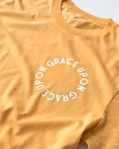 """You can easily read this shirt """"Grace upon grace upon grace upon grace upon grace upon grace...."""" and around and round you'll go and we did that on purpose. God's grace is never-ending. In John 1:16 it says """"For from his fullness we have all received grace upon grace."""" It's so encouraging to read this design in a circle because there are days where I need grace upon grace upon grace upon grace. Thankful for this bright shirt to remind me of that on days when I really need it. Shop new tee of…"""