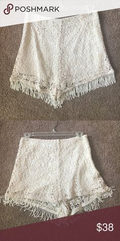 NWOT High waisted crochet and fringe shorts Pair with a simple tank for a fun and flirty outfit! Super comfortable and soft. Size S and never worn! Shorts