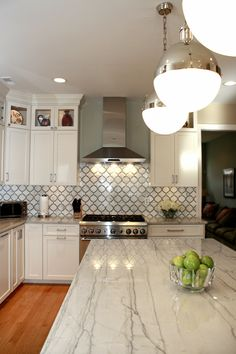 LOVE - White Macaubas Quartzite Countertops & Calacatta Gold backsplash - By Stoneshop. I have finally found what we are going to do!