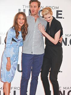 Star Tracks: Thursday, July 23, 2015 | FROM LONDON WITH LOVE  | There are more than enough hugs to go around for Alicia Vikander, Armie Hammer and Elizabeth Debicki during Thursday's photo call for their upcoming spy film, The Man from U.N.C.L.E., in London.