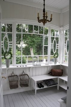 Four Season Porch - welcoming entryway with beautiful windows, painted floors and painted white interior walls and bench. Benches and wall hooks hung low work around the lack of wall space - via Lilla Villa Vita Enclosed Porches, Decks And Porches, Enclosed Porch Decorating, Sunroom Decorating, Sunroom Ideas, Patio Ideas, Interior Decorating, Style At Home, Shabby Chic