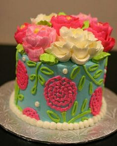 Gorgeous flowers on buttercream