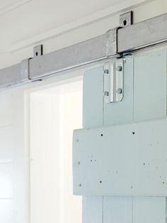 barn door between the kitchen & breezeway ~ love the blue & metal with the white - Coastal Chic Makeover : Interior Remodeling : HGTV Remodels