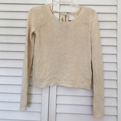 SALEUrban Outfitters crop sweater LOWEST PRICE! BRAND NEW super cute worn only once Urban Outfitters crop sweater size Small in cream. There is the tie detail in the back which is pictured above. Make an offer through the offer button! Urban Outfitters Sweaters