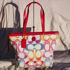 Coach Scribble Tote Used but in good condition authentic Coach Poppy bag. The inside of the handles have started to crack, but not noticeable when you are carrying the bag. Super cute bag!! If you have any questions please don't hesitate to ask!! Coach Bags Totes