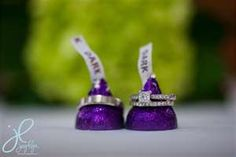 @Sara Allen would be PERFECT, since your colors are purple!   wedding rings, hershey kisses, dark, purple
