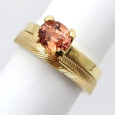 Custom one of a kind natural unheated Padparadscha sapphire ring in 18k yellow gold with hand engraving and matching band.
