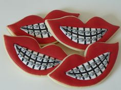 Orthodontist cookies - I made these cookies for my daughter who just had orthodontic treatment. I shined the braces with silver luster dust and vodka mixed together.