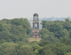 The Rockingham mausoleum A three-story building 90 ft high, situated in woodland, where only the top level is visible over the treetops; it was designed by John Carr, as an adaptation of the Roman Cenotaph of the Julii. The ground floor is an enclosed hall containing a statue of the first Marquess, and busts of his eight closest friends. The first floor is an open colonnade with Corinthian columns surrounding the sarcophagus. The top storey is a Roman-style cupola.