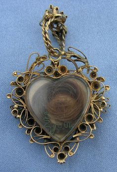 Georgian double sided heart momento mori  http://www.bing.com/images/search?q=victorian+hair+ornaments=detail=570A252006FF1A6C83BA2B7D093FC5EF2FC6E947=91=IDFRIR