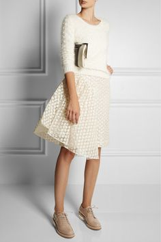 Very stylish- Simone Rochaskirt and shoes, Gucci top, Marni clutch.
