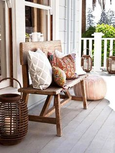 ❤ Simply soft- A pile of pillows softens any seat. Candles in lanterns warm the look.