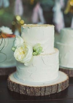 Small wedding cake with cupcakes on the side