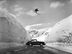 Egon Zimmermann jumps a Porsche in 1956, photo by Hans Truöl. Arlberg?