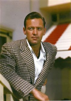 """William Holden. Can't say much for the sports coat he's wearing, but.... I was a child the first time I saw """"Sabrina"""" and instantly fell in Love with William Holden! I remember being very upset when """"Sabrina"""" stayed with the older brother.  As they used to say in the 40's and 50's. """"he's so dreamy..."""""""