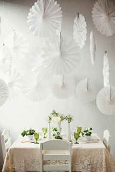 21 DIY Outdoor & Hanging Decor Ideas | Confetti Daydreams - DIY Paper Fan Rosettes inspired by the 1960s, these paper fan rosettes are great as pretty backdrops and statement above-the-table decor ♥ #DIY #OutdoorDecor #HangingDecor