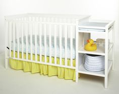 This White Crib Comes With A Changing Table And Storage.