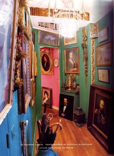 Different colours on the walls is an interesting idea as is the profusion of paintings, and the bookshelf near the ceiling.
