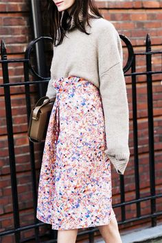 Play down the femininity of a floral skirt by pairing it with a chunky turtleneck